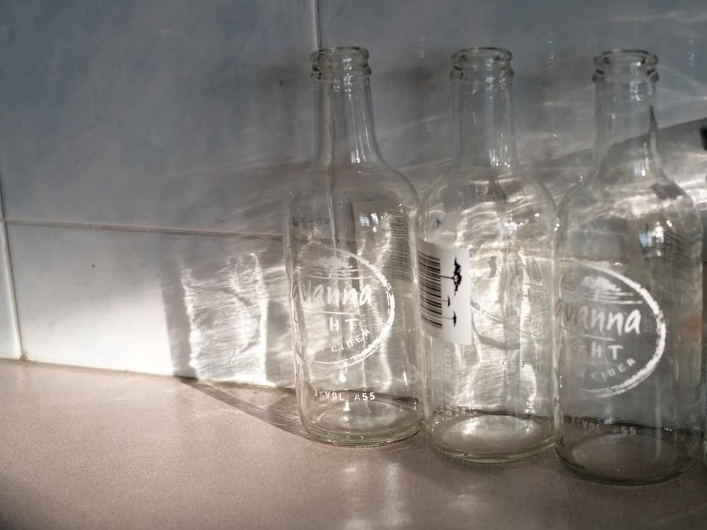 empty glass bottles under the sun